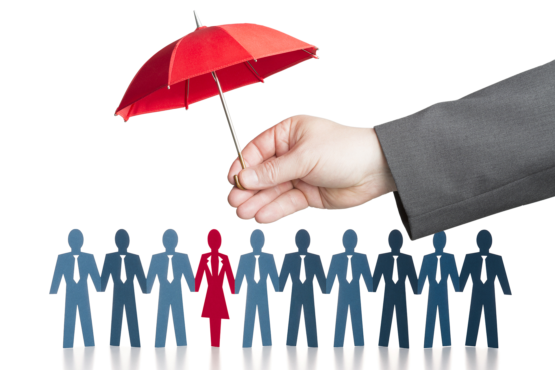 Business hand holding red protective umbrella over paper chain people